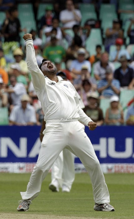 India's bowler Harbhajan Singh celebrates after dismissing South Africa's batsman Hashim Amla, unseen on LBW for 33 runs on the second day of the second test match at the Kingsmead stadium in Durban. (AP Photo)