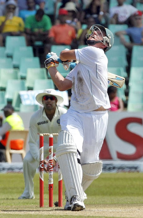 South Africa's captain Graeme Smith looks up as his shot is midair off India's bowler Shanthakumaran Sreesanth, on the third day of the second test match at the Kingsmead stadium in Durban. (AP Photo)