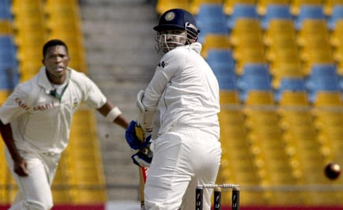 Virender Sehwag got India's innings off to an astonishing start, hitting Dale Steyn for two sixes in the first over. Here he whips Makhaya Ntini for four.