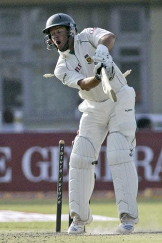 Mark Boucher reacts after his wickets are shattered by Ishant Sharma, unseen, during the first day of the third cricket Test match of the Future Cup series in Kanpur on Friday, April 11, 2008.