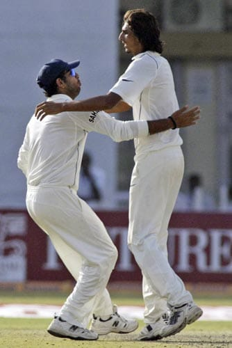 Yuvraj Singh, left, congratulates teammate Ishant Sharma after the latter dismissed South Africa's Mark Boucher, unseen, during the first day of the third cricket Test match of the Future Cup series in Kanpur on Friday, April 11, 2008.