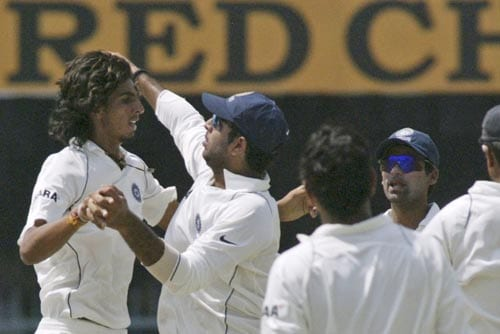 Teammates congratulate Ishant Sharma, left, after the dismissal of Hashim Amla, unseen, during the first day of the third cricket Test match of the Future Cup series in Kanpur on Friday, April 11, 2008.