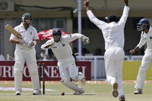Mahendra Singh Dhoni, second left, bowler Harbhajan Singh, second right, and Yuvraj Singh, right, celebrate the dismissal of Jacquis Kallis, left, during the first day of third cricket Test match of the Future Cup series in Kanpur on Friday, April 11, 2008.