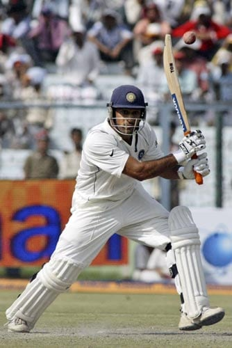 Mahendra Singh Dhoni hits the ball during the second day of the third Test cricket match of the Future Cup series in Kanpur on Saturday, April 12, 2008.