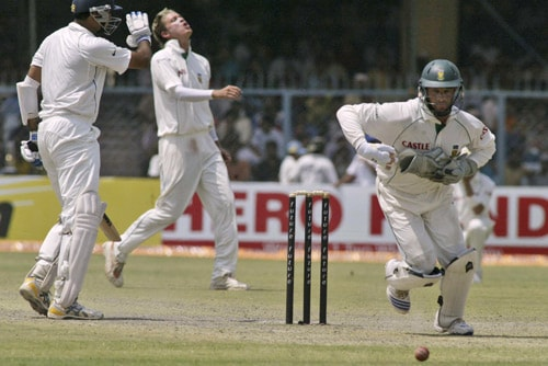 Mark Boucher, right, runs to catch a ball as bowler Morne Morkel, center, reacts while VVS Laxman, left, looks on during the second day of the third Test cricket match of the Future Cup series in Kanpur on Saturday, April 12, 2008.