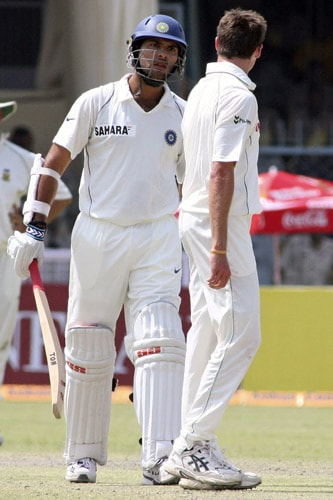 Dale Styen, right, and Yuvraj Singh talk during the second day of the third Test cricket match of the Future Cup series in Kanpur on Saturday, April 12, 2008.
