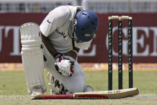 Rahul Dravid grimaces in pain as a ball hits his hand during the second day of the third Test match of the Future Cup series against South Africa, in Kanpur on Saturday, April 12, 2008.