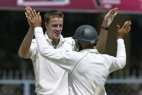 Morne Morkel, left, and Hashim Amla celebrate the dismissal of Wasim Jaffer, unseen, during the second day of the third Test cricket match of the Future Cup series in Kanpur on Saturday, April 12, 2008.