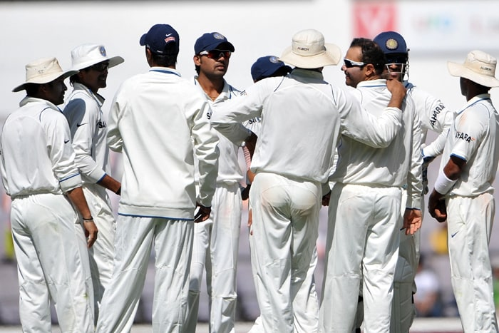 Indian cricketers celebrate the wicket of South African cricketer AB de Villiers on the second day of the first Test match between India and South Africa in Nagpur. (AFP Photo)