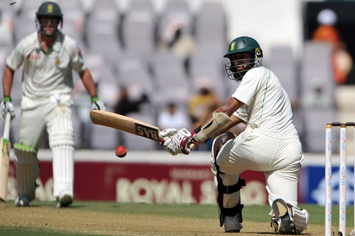 South African cricketer Hashim Amla hits a shot during his double century stand on the second day of the first cricket Test match between India and South Africa in Nagpur. (AFP Photo)