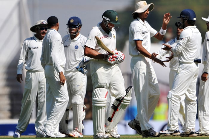 Indian players celebrate the dismissal of Jacques Kallis after the latter scored a marathon 173. (AFP Photo)