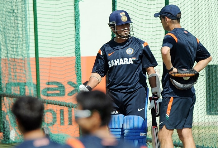 Sachin Tendulkar with coach Gary Kirsten during a practice session in Jaipur's Swai Mansingh Cricket Stadium. India are scheduled to play 3 ODIs against South Africa. (AFP Photo)
