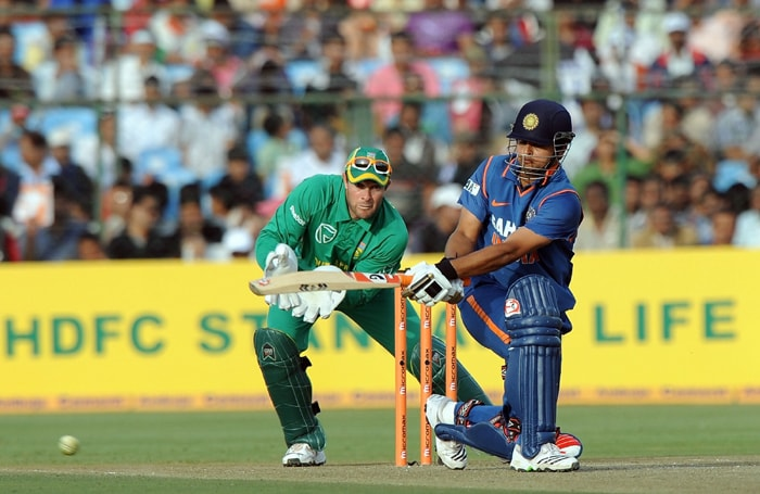 Suresh Raina hits one on the way to his half century against South Africa. (AFP Photo)