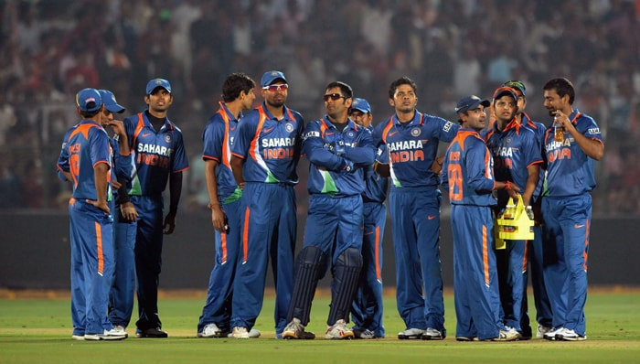 Team India wait for a pending run-out decision by the third umpire. (AFP Photo)