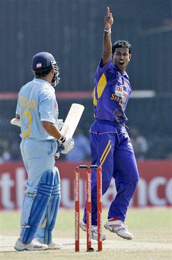 Nuwan Kulasekara celebrates the dismissal of Sachin Tendulkar during the second One-Day International between India and Sri Lanka in Colombo on January 31, 2009.