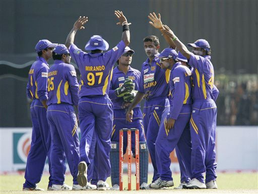 Sri Lankan team congratulate their bowler Farveez Maharoof for taking the wicket of Gautam Gambhir during the second One-Day International between India and Sri Lanka in Colombo.