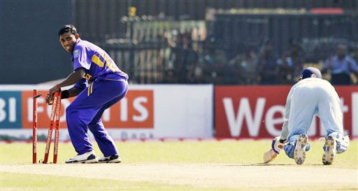 Thilina Thushara breaks the wicket to dismiss Virender Sehwag during the second One-Day International between India and Sri Lanka in Colombo.
