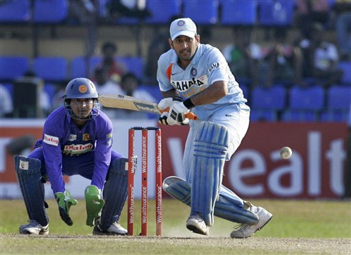 Mahendra Singh Dhoni plays a shot as wicket-keeper Kumar Sangakkara looks on during the final ODI match between India and Sri Lanka in Colombo on Sunday. (AP Photo)