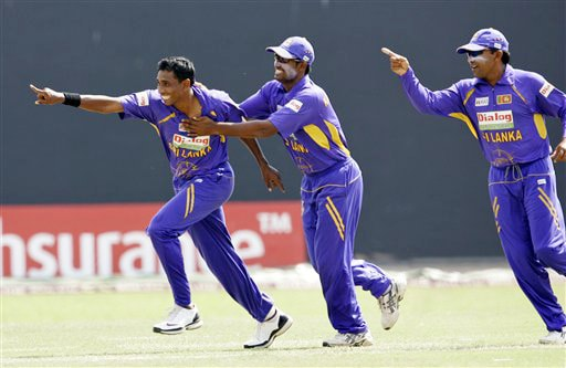 Thilan Thushara, Chamara Kapugedara and Mahela Jayawardene celebrate the dismissal of Virender Sehwag during the final ODI match between India and Sri Lanka in Colombo on Sunday. (AP Photo)