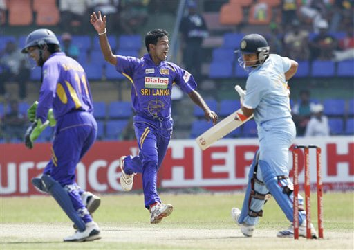 Nuwan Kulasekera and wicket-keeper Kumar Sangakkara celebrate the dismissal of Suresh Raina during the final ODI match between India and Sri Lanka in Colombo on Sunday. (AP Photo)