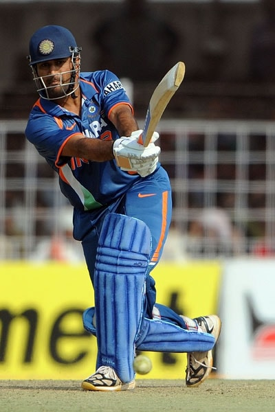Mahendra Singh Dhoni plays a shot during the first ODI between India and Sri Lanka in Rajkot. (AFP Photo)