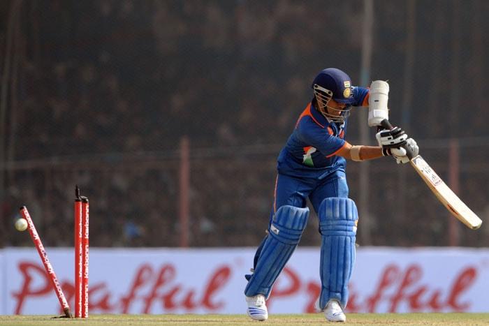 Sachin Tendulkar is clean bowled during the first ODI between India and Sri Lanka in Rajkot. (AFP Photo)