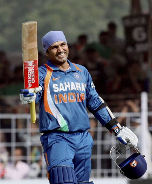 Virender Sehwag reacts after completing his century against Sri Lanka during the first ODI at the Madhaorao Scindia Stadium in Rajkot. (PTI Photo)