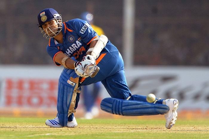 Sachin Tendulkar plays a shot during on the first ODI between India and Sri Lanka in Rajkot. (AFP Photo)