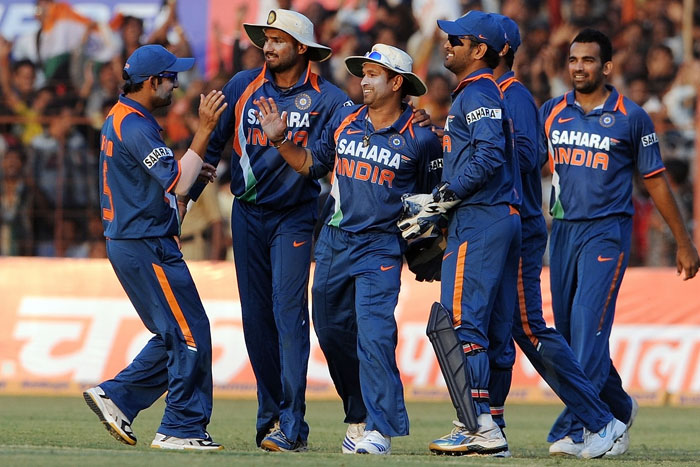 Indian cricketers celebrate the wicket of Angelo Mathews during the first ODI between India and Sri Lanka in Rajkot. (AFP Photo)