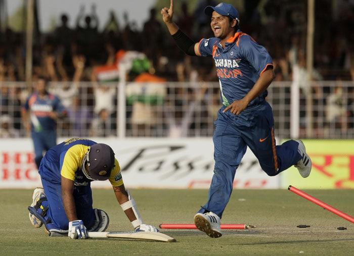 India's Suresh Raina celebrates the dismissal of Sri Lanka's Mahela Jayawardene during their first One-Day International in Rajkot. (AP Photo)