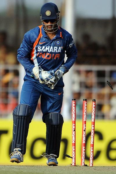 Mahendra Singh Dhoni stumps out Sanath Jayasuriya during the first ODI between India and Sri Lanka in Rajkot. (AFP Photo)