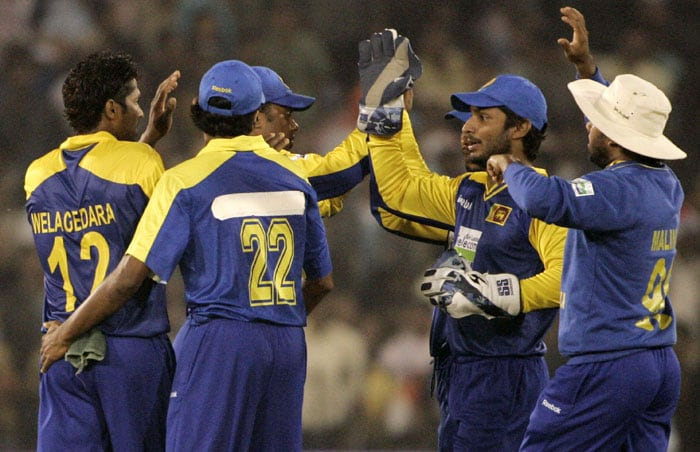 Sri Lankan players celebrate the dismissal of Virender Sehwag during the third ODI in Cuttack. (AP Photo)