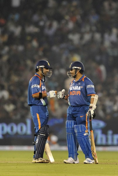 Gautam Gambhir and Sachin Tendulkar interact during the 3rd ODI against Sri Lanka at the Barabati Stadium in Cuttack. (AFP Photo)