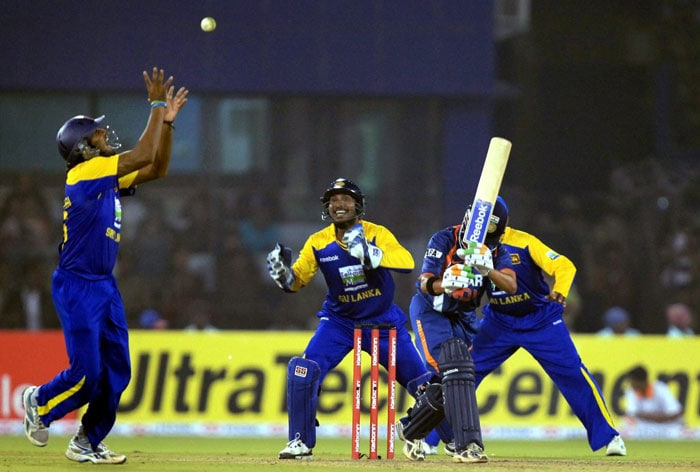 Sri Lankan cricketer takes catch of Gautam Gambhir during the 3rd ODI at Barabati Stadium in Cuttack. (PTI Photo)