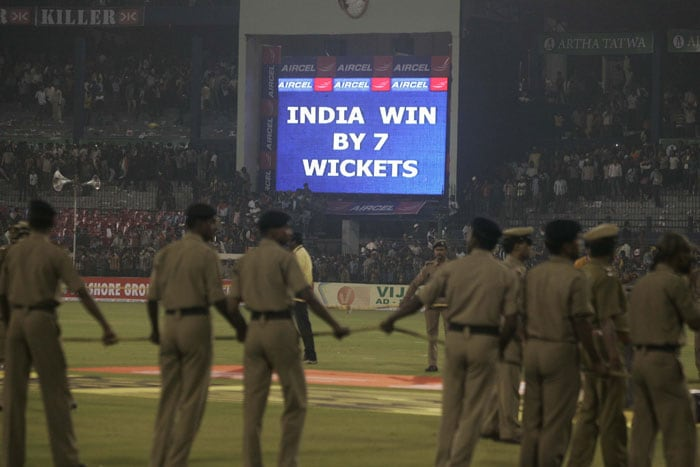 Police cordons off the presentation area as the large screen displays India won the match against Sri Lanka during their third ODI in Cuttack. (AP Photo)