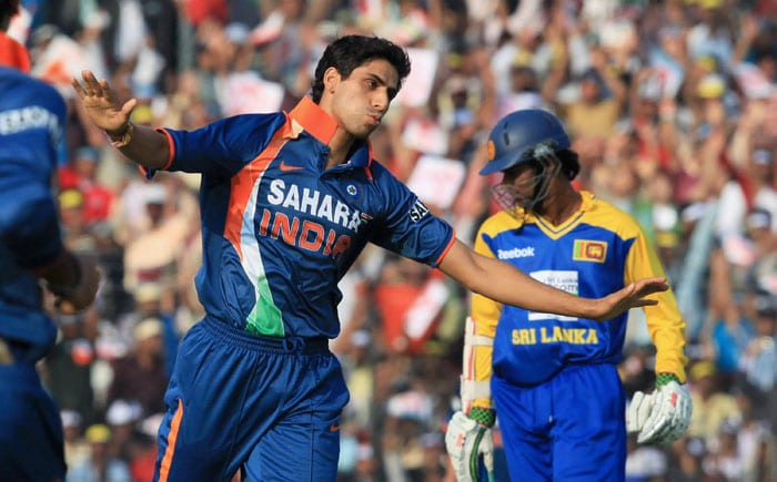 Ashish Nehra celebrates after claiming the wicket of Tillakaratne Dilshan during the 3rd ODI between India and Sri Lanka at Barabati Stadium in Cuttack. (PTI Photo)