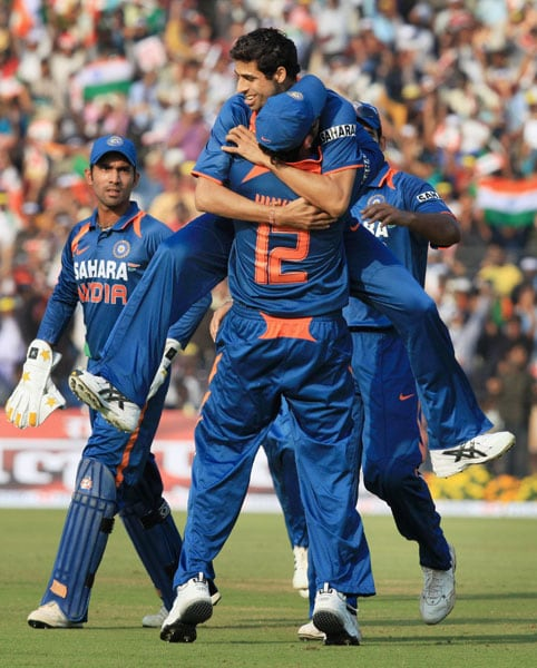Ashish Nehra celebrates with Yuvraj Singh after claiming the wicket of Dilshan during the 3rd ODI between India and Sri Lanka at Barabati Stadium in Cuttack. (PTI Photo)