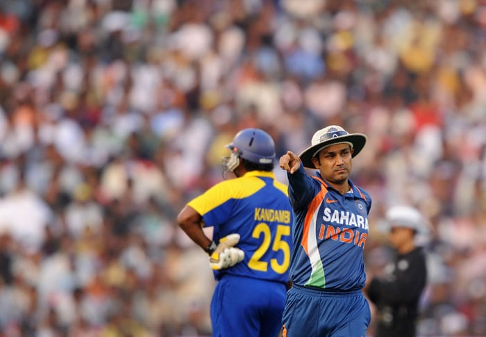 Indian stand-in captain Virender Sehwag points during the 3rd ODI against Sri Lanka at the Barabati Stadium in Cuttack. (AFP Photo)
