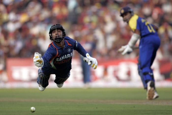 Dinesh Karthik dives to catch the ball off Mahela Jayawardene's bat during the third ODI between India and Sri Lanka in Cuttack. (AP Photo)