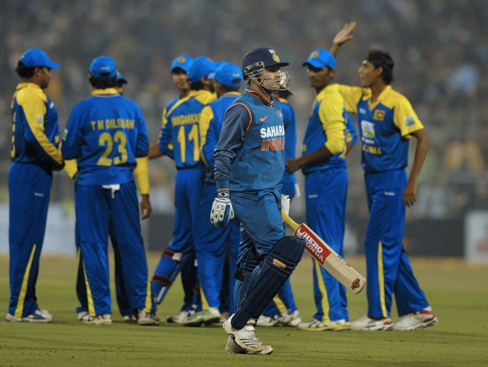 Sri Lankan cricketers celebrate the dismissal of Virender Sehwag during the fourth ODI against India at Eden Gardens Stadium in Kolkata. (AFP Photo)