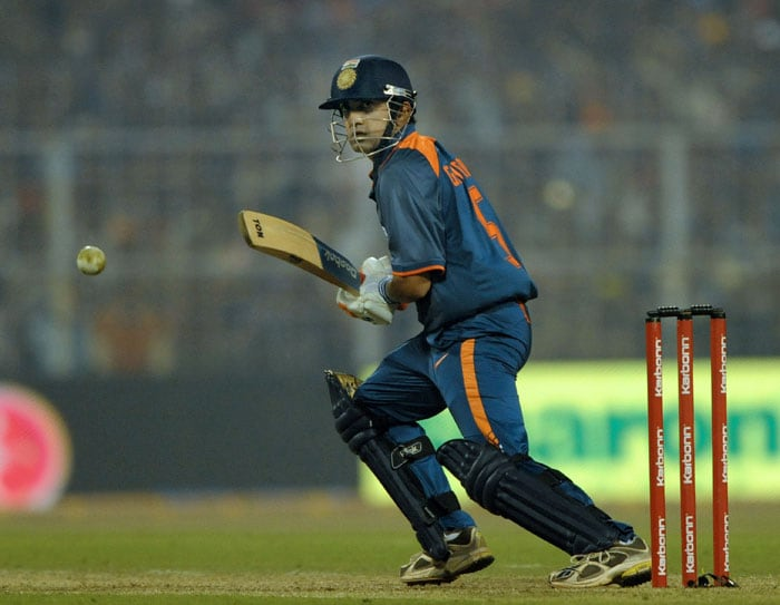 Gautam Gambhir watches the ball after playing a stroke during the fourth ODI between India and Sri Lanka at Eden Gardens Stadium in Kolkata. (AFP Photo)