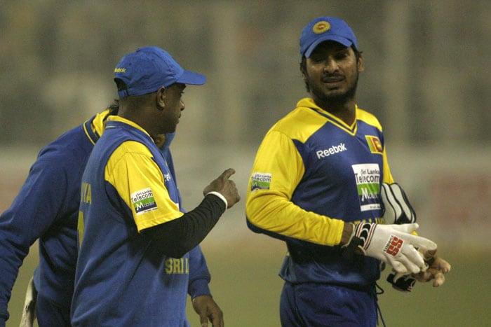 Sri Lankan captain Kumar Sangakara and Sanath Jayasuriya walk off the ground after losing the fourth ODI to India in Kolkata. (AP Photo)
