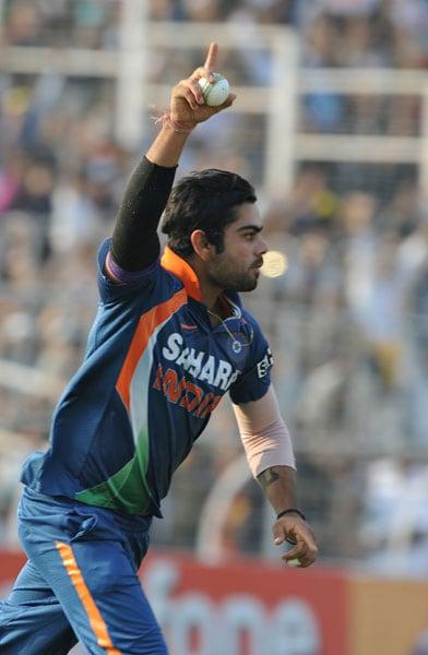 Virat Kohli celebrates the dismissal of Tillakaratne Dilshan during the fourth ODI between India and Sri Lanka at Eden Gardens Stadium in Kolkata. (AFP Photo)