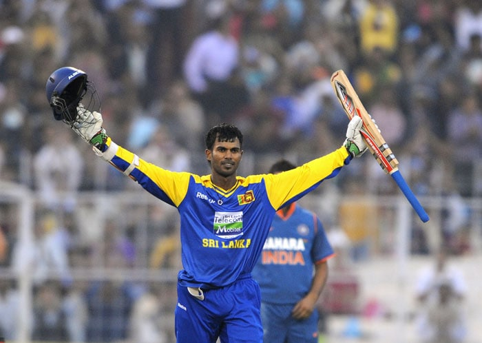 Upul Tharanga gestures after scoring a century (100 runs) during the fourth ODI against India at Eden Gardens Stadium in Kolkata. (AFP Photo)
