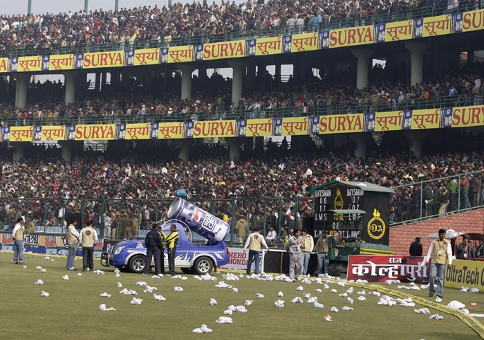Rolled seat covers are seen lying on the ground after spectators threw them in protest after the fifth and final ODI between India and Sri Lanka was abandoned at the Feroz Shah Kotla stadium in New Delhi. A dangerous pitch caused the match to be abandoned. (AP Photo)