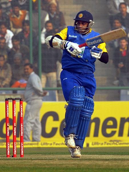 Sanath Jayasuriya plays a stroke to the boundary during the fifth and final ODI between India and Sri Lanka at the Feroz Shah Kotla in New Delhi. (AFP Photo)