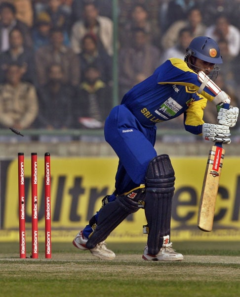 Upul Tharanga is bowled out by India's Zaheer Khan during the fifth and final ODI between India and Sri Lanka in New Delhi. (AP Photo)