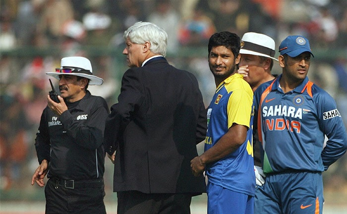 Kumar Sangakkara has a discussion with the umpires and match referee as MS Dhoni looks on during the final India-Sri Lanka ODI in New Delhi. (PTI Photo)