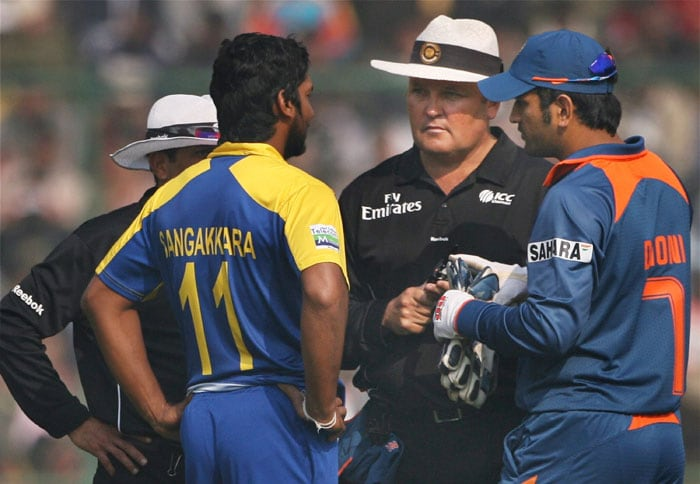Kumar Sangakkara and MS Dhoni have a discussion with the umpires during the final India-Sri Lanka ODI in New Delhi. (PTI Photo)