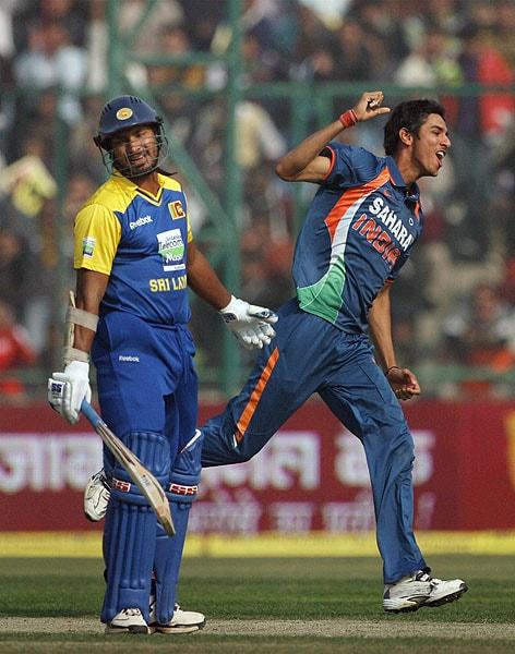 Sudeep Tyagi celebrates the wicket of Kumar Sangakkara during the final one-dayer between the two countries at Feroz Shah Kotla stadium in New Delhi. (PTI Photo)
